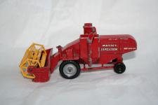 a red die cast matchbox combine harvester, the operative is missing and the paint is slightly chipped