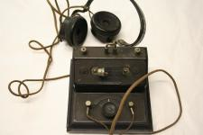 a crystal radio set with earphones and wires visible