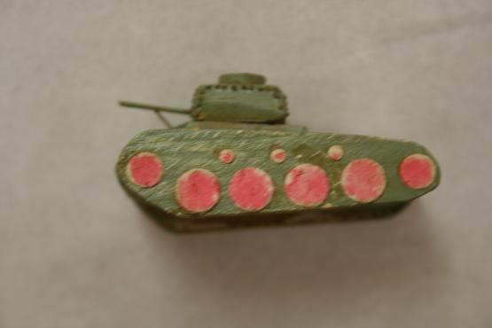 a small green wooden tank